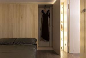 Wooden-cabinet-for-closet-on-the-bedroom-ideas-with-laminate-flooring-wooden-wall-bed-and-cushion-this-is-simple-and-unique-design-interior