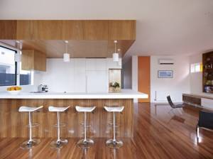 White-bar-stool-white-pendant-lamp-parwuet-teak-wood-floor-aminated-wooden-door-white-kitchen-cabinet-ac-615x461