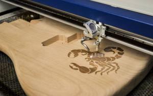 Wood-guitar-engraving